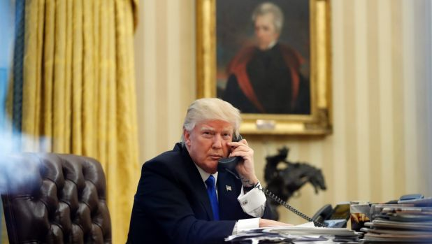 President Donald Trump speaks on the phone with Prime Minister of Australia Malcolm Turnbull in the Oval Office of the ...