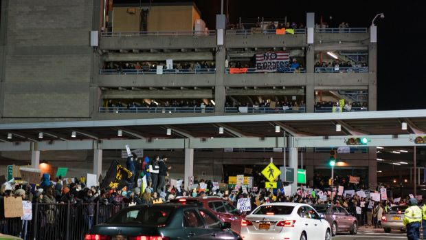 Crowds have protested the bans at John F Kennedy International Airport in New York.