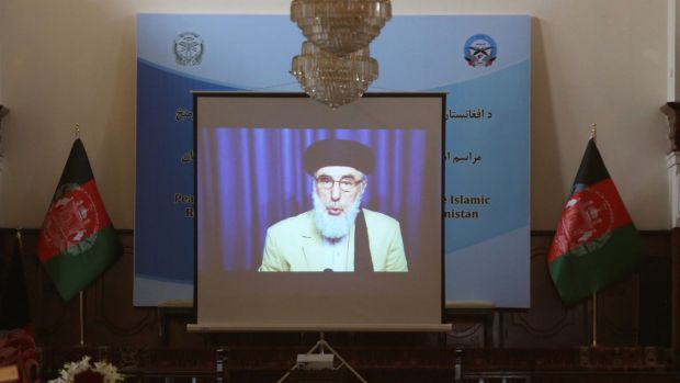A screen shows live broadcast of Gulbuddin Hekmatyar during the signing  of a peace treaty between his faction and the ...
