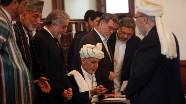 Afghan President Ashraf Ghani, centre, with Afghan chief executive Abdullah Abdullah third from left and former ...