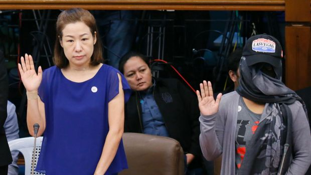 Choi Kyung-jin, left, the widow of South Korean businessman Jee Ick-joo, and their former housekeeper Marissa Morquicho ...