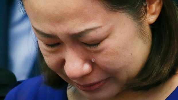 Choi Kyung-jin, the widow of South Korean businessman Jee Ick-joo, who was kidnapped and later killed by his abductors, ...