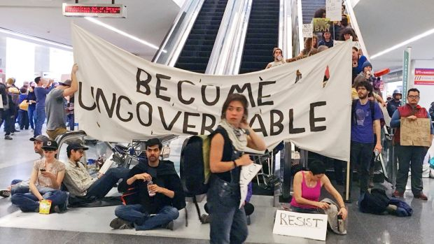 Demonstrators block an escalator at the international terminal as protests countries continue at San Francisco ...