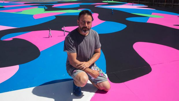 Reko Rennie with his work <i>Visible Invisible</i> on the foundation of Corbett Lyon's new Housemuseum in Kew.
