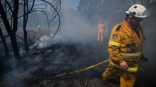 RFS crews battle a grass fire in Claremont Meadows on Tuesday as January came to a scorching end.