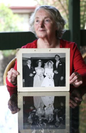 Elaine Postlethwaite with a photo from her wedding day.