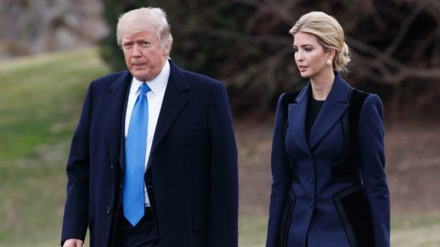 President Donald Trump and his daughter Ivanka walk to board Marine One on the South Lawn of the White House in Washington.