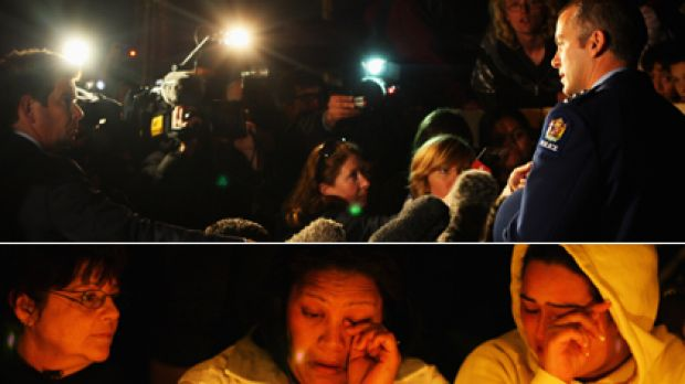 Inspector Gary Davey tells waiting media that the police have found the body of a young child. Below, people mourn ...