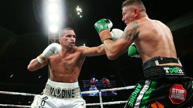 Anthony Mundine reaches out.