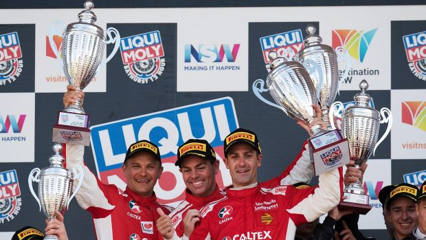 Controlled aggression: Toni Vilander, Craig Lowndes and Jamie Whincup celebrate the win.