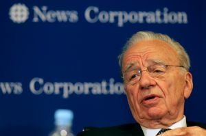 Smiling all the way to the bank: Rupert Murdoch.
