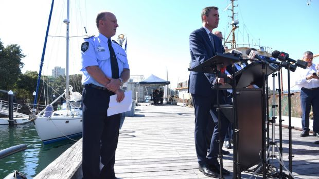 Australian Federal Police acting Deputy Commissioner Neil Gaughan and Justice Minister Michael Keenan announce ...