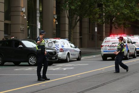 Police at the scene of the shooting, outside the AFP building in Melbourne.