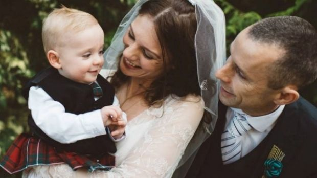 """The couple with their son Charlie who looked """"cute as a button"""" on their wedding day."""