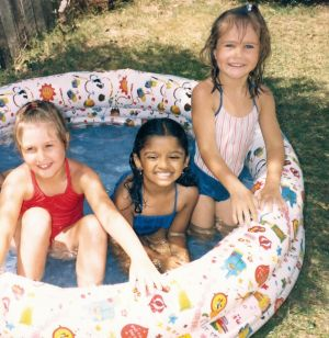 Vimala, age four, with friends in her Sydney backyard.
