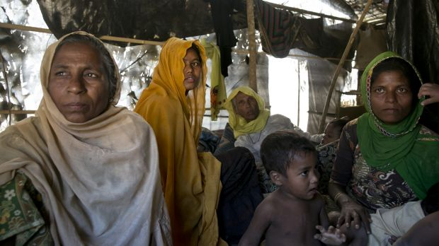 Women and children in a makeshift house they share with six others in a Rohingya refugee camp in Cox's Bazar, ...