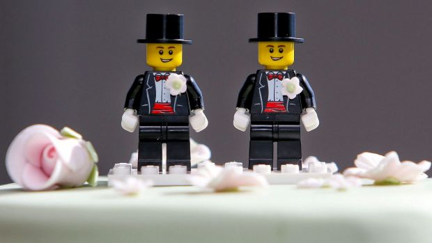 Two Lego men decorate the top of Paul McCarthy and Trent Kandler's wedding cake. The Australian couple was flown to ...