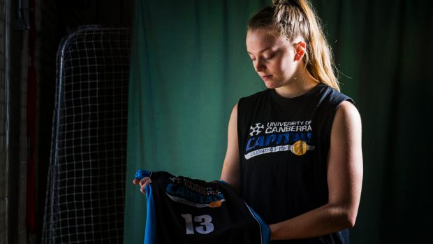 Canberra Capital Abigail Wehrung with her No. 13 jersey as a tribute to her father, who died 12 years ago.