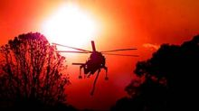SPECIAL 000000 bushfire;020101;pic nick moir;smh;news; pic shows elvis working in a blood red sky in maquarie park