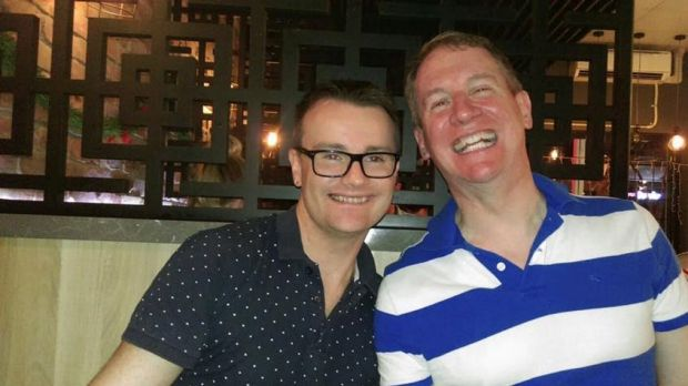 Stephen Page (right) with husband Mitchell Page.