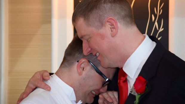 Stephen Page (right) with husband Mitchell Page at their Vegas wedding.