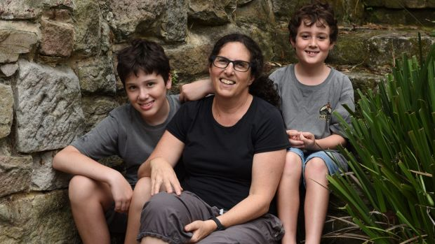 Robyn Bernstein, with her sons Ed and Kai Hall, questions why Special Religious Education should be held in class time.