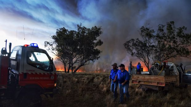 Farmers battle a fire that started with a lightning strike near a larger blaze west of Cassilis.
