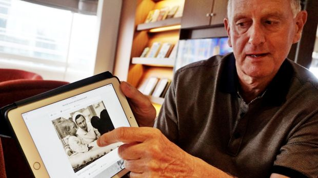 Michael Noyce shows a photo of his aunt at work during the war.