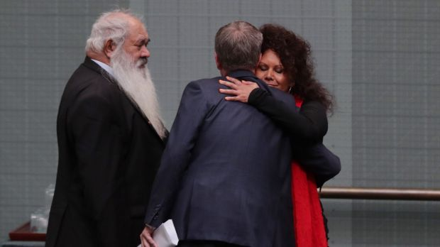 Bill Shorten hugs Senator Malarndirri McCarthy after Malcolm Turnbull delivered the Closing the Gap report at Parliament ...