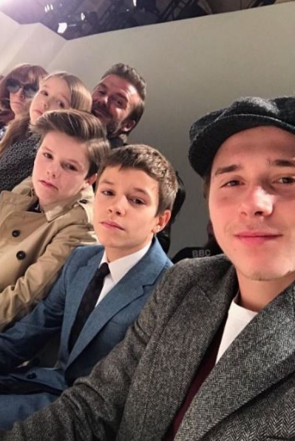 David Beckham sat front row at Victoria Beckham's runway show, with the couple's children, Brooklyn, Romeo, Cruz and ...