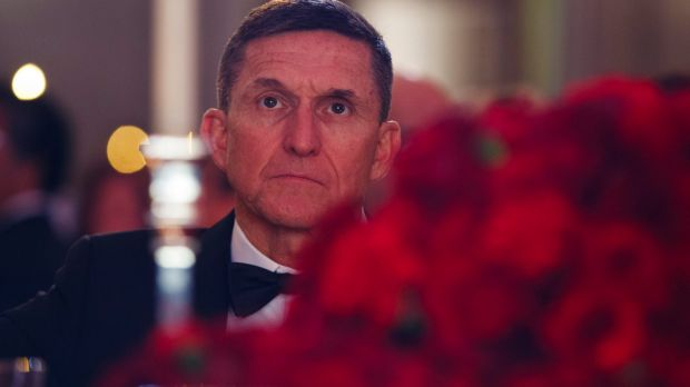 Michael Flynn listens during the presidential inaugural Chairman's Global Dinner on January 17.