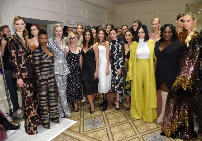 It was all about pantsuits and bold hues with the cast of OINTB meeting fashion. Samira Wiley, Coco Rocha, Lauren ...