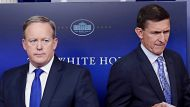 National Security Adviser Michael Flynn walks past White House press secretary Sean Spicer to the podium to speak during ...