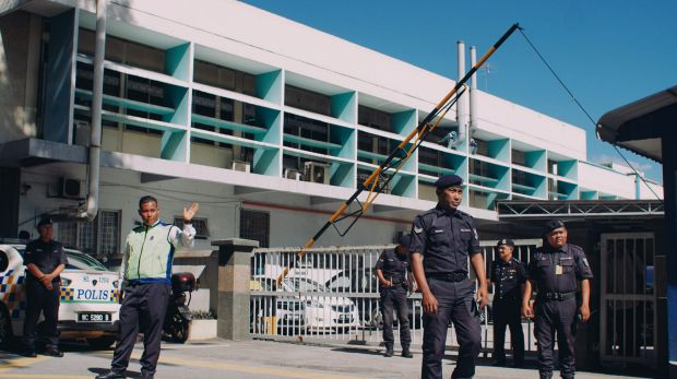 Police officers guard the entrance of the forensic department of Kuala Lumpur General Hospital on Wednesday.