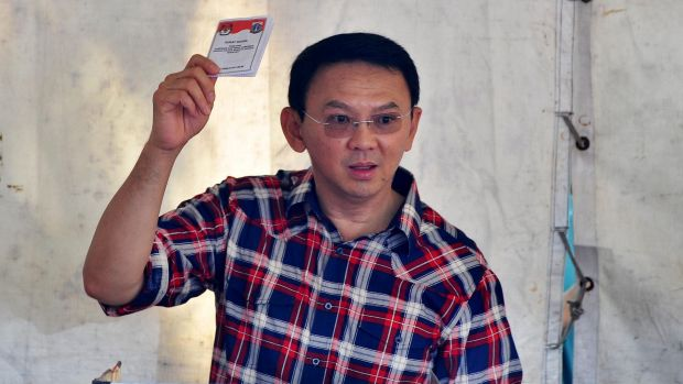 Jakarta Governor Ahok votes in the first round in February.
