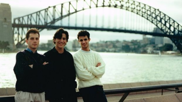 Ross Farhadieh (centre) in 1993 during his medical school days, sporting era-appropriate hair.
