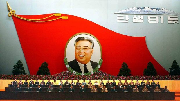 A huge flag-shaped painting featuring the late North Korean President Kim Il-sung is at an annual meeting to mark the ...