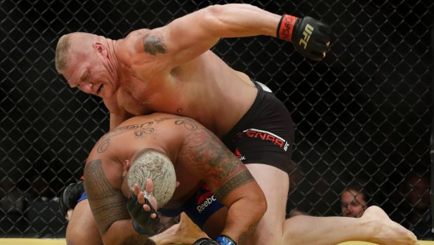 Brock Lesnar, top, fights Mark Hunt during UFC 200.