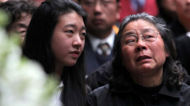 Brenda Lin and her grandmother Feng Qing Zhu at the Lin family funeral in 2009.