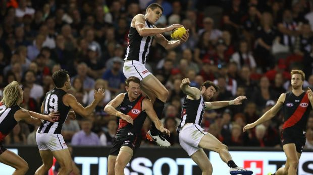 High flyer: Mason Cox in action for the Magpies.
