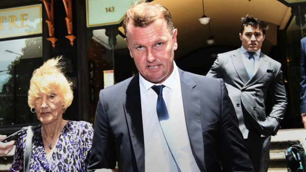 Celebrity accountant Anthony Bell leaving court with mum Shirley.