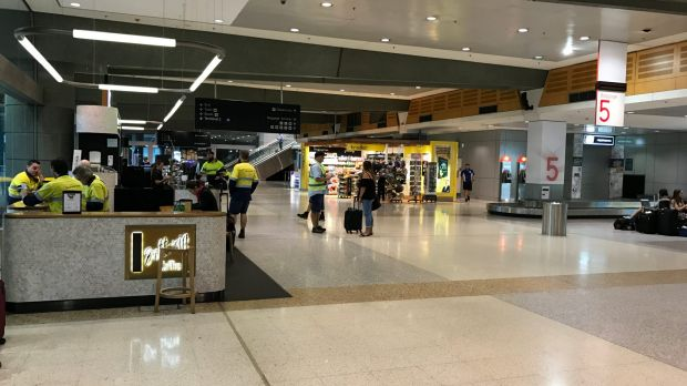 The Qantas domestic terminal is deserted as a storm hits Sydney.