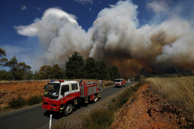 Firefighters respond to a fire at Carwoola, southeast of Canberra.