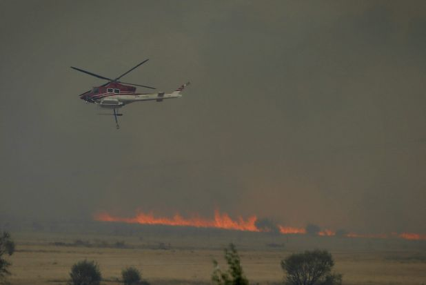 Helicopters responding to a fire at Carwoola, southeast of Canberra.