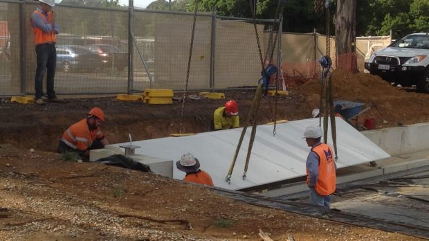 Workers have begun installing the first part of the memorial on Anzac Parade.