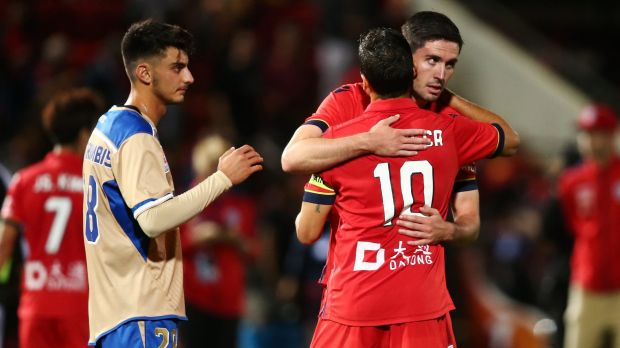 Coolly done: Dylan McGowan congratulates Marcelo Carrusca, who scored the winning goal.