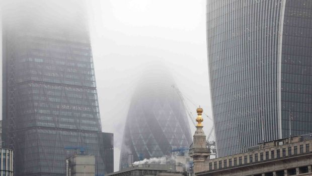 "The London skyscraper known as ""the Gherkin"" stands shrouded in smog as heavy pollution descends on the city."