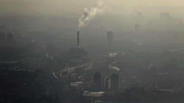 Pollution is seen over south east London through a window in a viewing area of the 95-storey skyscraper The Shard.