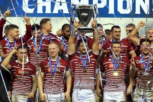 World Club champions Wigan celebrate their famous victory over the Sharks in February.
