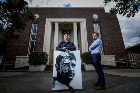 Dominik Kul (right) and Sean Burton outside the defence building at 310 St Kilda Road that the defence department is selling.